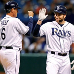 Tampa Bay Rays' Luke Scott, right, is congratulated by third base coach Tom Foley following his RBI triple during the first inning of a baseball game against the Cleveland Indians on 3Tuesda …