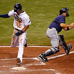 Tampa Bay Rays' Desmond Jennings, left, scores on a single by Jose Lobaton as Cleveland Indians catcher Lou Marson waits for the late throw during the sixth inning of a baseball game Tuesday …