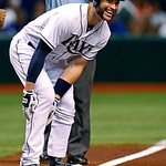 Tampa Bay Rays' Luke Scott reacts to his teammates' cheers from the dugout following his RBI triple during the first inning of a baseball game against the Cleveland Indians on Tuesday, July  …