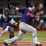 Cleveland Indians' Jason Kipnis, right, is tagged out on a dropped third strike by Tampa Bay Rays catcher Jose Lobaton during the eighth inning of a baseball game Tuesday, July 17, 2012, in  …