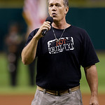 William Dillion, of the Innocence Project, sings the national anthem before a baseball game between the Tampa Bay Rays and the Cleveland Indians, Wednesday, July 18, 2012, in St. Petersburg, …