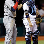 Cleveland Indians' Asdrubal Cabrera, left, reacts after scoring on a seventh-inning RBI single by teammate Michael Brantley off Tampa Bay Rays relief pitcher Jake McGee during a baseball gam …