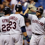 Cleveland Indians' Carlos Santana, right, celebrates with teammates Jason Kipnis, left, and Michael Brantley, center, after his seventh-inning three-run home run off Tampa Bay Rays relief pi …