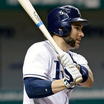 Tampa Bay Rays' Luke Scott follows through on a third-inning RBI single off Cleveland Indians starting pitcher Justin Masterson during a baseball game, Wednesday, July 18, 2012, in St. Peter …