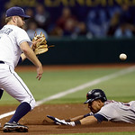 Cleveland Indians' Michael Brantley, right, slides into third base with a second-inning triple ahead of the throw to Tampa Bay Rays third baseman Jeff Keppinger during a baseball game, Wedne …