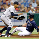 Tampa Bay Rays&#039; Jeff Keppinger, right, slides into third base with a triple ahead of the tag by Cleveland Indians third baseman Jose Lopez during the third inning of a baseball game, Thursda &#8230;