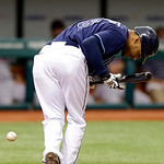 Tampa Bay Rays&#039; Desmond Jennings dives out of the way after getting hit with a sixth-inning pitch from Cleveland Indians&#039; Ubaldo Jimenez during a baseball game,Thursday July 19, 2012, in St. &#8230;