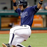 Tampa Bay Rays&#039; Sean Rodriguez slides home to score on a three-run double by teammate B.J. Upton off of Cleveland Indians starting pitcher Ubaldo Jimenez during the sixth inning of a basebal &#8230;