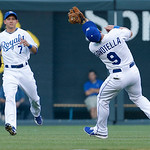 Kansas City Royals second baseman Johnny Giavotella (9) catches a fly ball in front of right fielder David Lough (7) during a baseball game against the Cleveland Indians at Kauffman Stadium  …