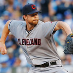 Cleveland Indians starting pitcher Corey Kluber delivers to an Kansas City Royals batter during the first inning of a baseball game at Kauffman Stadium in Kansas City, Mo., Tuesday, July 2, …