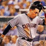 Cleveland Indians' Asdrubal Cabrera takes off his helmet after scoring a go-ahead run during the seventh inning of a baseball game at Kauffman Stadium in Kansas City, Mo., Tuesday, July 2, 2 …