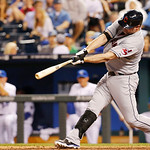 Cleveland Indians designated hitter Jason Giambi hits an RBI double during the seventh inning of a baseball game against the Kansas City Royals at Kauffman Stadium in Kansas City, Mo., Tuesd …