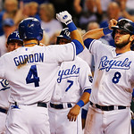Kansas City Royals' Alex Gordon (4) is congratulated by teammate Mike Moustakas (8) after hitting a grand slam off Cleveland Indians starting pitcher Corey Kluber during the fifth inning of …