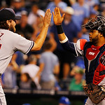 Cleveland Indians relief pitcher Chris Perez, left,  is congratulated by catcher Carlos Santana, right, following a baseball game against the Kansas City Royals at Kauffman Stadium in Kansas …