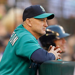 Seattle Mariners bench coach Robby Thompson leans on the dugout wall in the third inning of a baseball game against the Cleveland Indians, Monday, July 22, 2013, in Seattle. Thompson managed …