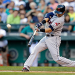 Cleveland Indians' Nick Swisher, batting in the #2 position, hits a solo home run against the Seattle Mariners in the first inning of a baseball game, Monday, July 22, 2013, in Seattle. (AP …