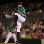 Seattle Mariners closing pitcher Tom Wilhelmsen throws during a baseball game against the Cleveland Indians, Monday, July 22, 2013, in Seattle. (AP Photo/Ted S. Warren)
