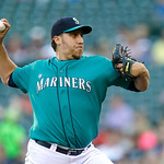 Seattle Mariners starting pitcher Aaron Harang throws against the Cleveland Indians in the second inning of a baseball game, Monday, July 22, 2013, in Seattle. (AP Photo/Ted S. Warren)