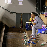 Cleveland Indians' Asdrubal Cabrera sits in the empty visitors dugout after the Seattle Mariners beat the Indians 2-1 in a baseball game, Monday, July 22, 2013, in Seattle. (AP Photo/Ted S. …