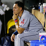 Cleveland Indians' Asdrubal Cabrera sits in the empty visitors' dugout after the Seattle Mariners beat the Indians 2-1 in a baseball game, Monday, July 22, 2013, in Seattle. (AP Photo/Ted S. …
