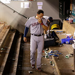 Cleveland Indians' Asdrubal Cabrera walks through the empty visitors' dugout after the Seattle Mariners beat the Indians 2-1 in a baseball game, Monday, July 22, 2013, in Seattle. (AP Photo/ …