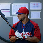 Cleveland Indians' Mike Aviles waits in the dugout during batting practice before a baseball game against the Seattle Mariners, Monday, July 22, 2013, in Seattle. (AP Photo/Ted S. Warren)