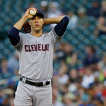 Cleveland Indians starting pitcher Ubaldo Jimenez pauses on the mound during a baseball game against the Seattle Mariners, Monday, July 22, 2013, in Seattle. (AP Photo/Ted S. Warren)