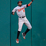 Baltimore Orioles&#039; Adam Jones jumps high to catch a fly ball hit by Cleveland Indians&#039; Shin-Soo Choo in the fifth inning in a baseball game, Monday, July 23, 2012, in Cleveland. Choo was out &#8230;