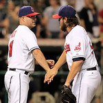 Cleveland Indians manager Manny Acta, left, congratulates pitcher Chris Perez after the Indians defeated the Baltimore Orioles 3-1 in a baseball game, Monday, July 23, 2012, in Cleveland. (A &#8230;