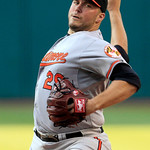 Baltimore Orioles starting pitcher Tommy Hunter delivers in the first inning of a baseball game against the Cleveland Indians, Monday, July 23, 2012, in Cleveland. (AP Photo/Tony Dejak)