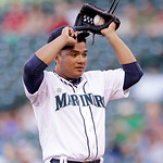 Seattle Mariners starting pitcher Erasmo Ramirez adjusts his cap after giving up a run against the Cleveland Indians in the first inning of a baseball game Tuesday, July 23, 2013, in Seattle …