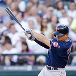 Cleveland Indians' Asdrubal Cabrera drives in a run with a single against the Seattle Mariners in the first inning of a baseball game Tuesday, July 23, 2013, in Seattle. (AP Photo/Elaine Tho …