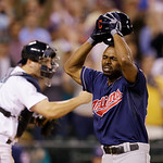 Cleveland Indians' Michael Bourn, right, pulls off his helmet as he reacts to striking out looking to end the baseball game as Seattle Mariners' catcher Mike Zunino heads to the mound Tuesda …