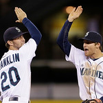Seattle Mariners Nick Franklin (20) and Brad Miller share congratulations after the team beat the Cleveland Indians in  a baseball game Tuesday, July 23, 2013, in Seattle. The Mariners won 4 …