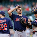 Cleveland Indians starting pitcher Zach McAllister, center, talks with catcher Yan Gomes, right, and Jason Kipnis between Seattle Mariners batters in the first inning of a baseball game Tues …