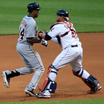 Cleveland Indians catcher Carlos Santana, right, tags out Detroit Tigers' Austin Jackson in the fourth inning in a baseball game, Thursday, July 26, 2012, in Cleveland. Jackson was caught in …
