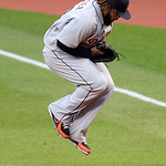 Detroit Tigers' Prince Fielder jumps to catch the ball hit by Cleveland Indians' Casey Kotchman in the third inning of a baseball game, Thursday, July 26, 2012, in Cleveland. Kotchman was ou …