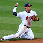 Cleveland Indians' Asdrubal Cabrera throws to first base to get Detroit Tigers' Ramon Santiago in the second inning of a baseball game, Thursday, July 26, 2012, in Cleveland. Santiago was sa …
