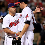 Cleveland Indians manager Manny Acta, left, pats starting pitcher Zach McAllister on the back as McAllister walks toward the dugout in the seventh inning of a baseball game, Thursday, July 2 …