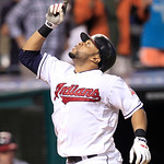Cleveland Indians' Carlos Santana looks up after hitting a solo home run off Detroit Tigers' Justin Verlander in the seventh inning of a baseball game, Thursday, July 26, 2012, in Cleveland. …