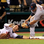 Cleveland Indians' Asdrubal Cabrera, left, slides safely back to third base as Detroit Tigers' Miguel Cabrera is late on the tag in the seventh inning of a baseball game, Thursday, July 26,  …