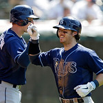 Tampa Bay Rays' Will Rhymes, right, celebrates his solo home run off Cleveland Indians relief pitcher Chris Perez with teammate Elliot Johnson in the ninth inning of a baseball game on Sunda …