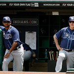 Tampa Bay Rays manager Joe Maddon, right, and bench coach Dave Martinez watch from the dugout during a baseball game against the Cleveland Indians Sunday, July 8, 2012, in Cleveland. (AP Pho …