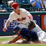 Tampa Bay Rays' Carlos Pena, bottom, slides into third with an RBI-triple as the throw eludes Cleveland Indians third baseman Jack Hannahan in the ninth inning of a baseball game on Sunday,  …