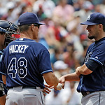 Tampa Bay Rays starting pitcher James Shields, right, gets a visit from pitching coach Jim Hickey (48) in the third inning of a baseball game against the Cleveland Indians, Sunday, July 8, 2 …