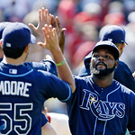 Tampa Bay Rays relief pitcher Fernando Rodney, right, celebrates with his teammates after a 7-6 win over the Cleveland Indians in a baseball game on Sunday, July 8, 2012, in Cleveland. Rodne …