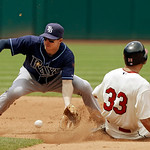 Cleveland Indians' Johnny Damon (33) steals second base as Tampa Bay Rays shortstop Elliot Johnson takes the throw in the fourth inning of a baseball game on Sunday, July 8, 2012, in Clevela …