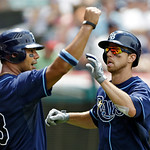 Tampa Bay Rays' Ben Zobrist, right, and Carlos Pena celebrate after scoring on a double by Luke Scott in the sixth inning of a baseball game against the Cleveland Indians, Sunday, July 8, 20 …