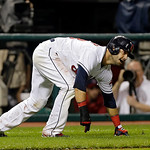 Cleveland Indians' Nick Swisher slips rounding third on a single by Michael Brantley in the 10th inning of a baseball game against the Detroit Tigers Monday, July 8, 2013, in Cleveland. The  …