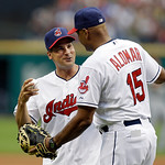 Former Cleveland Indians shortstop Omar Vizquel, left, gets a hug from bench coach Sandy Alomar, Jr. after throwing out a ceremonial pitch before a baseball game against the Detroit Tigers o …